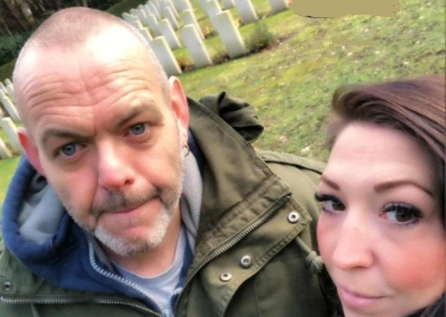 John and Sharon Esser, a Dutch couple who have adopted the grave of a British war hero EMN-210302-085447001