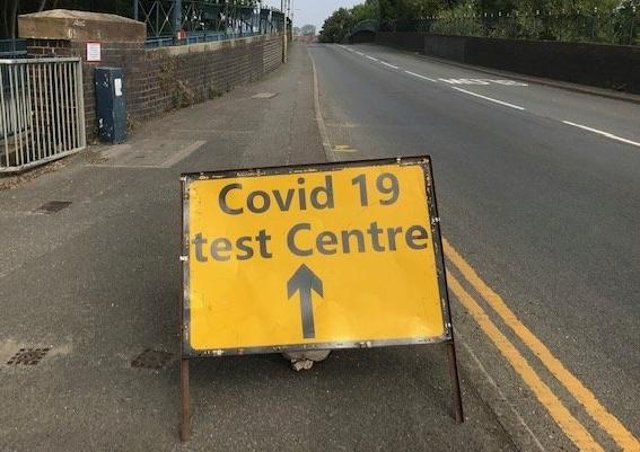 A sign on Burton Road bridge flagging up a Covid-19 test site in Melton EMN-210323-104937001