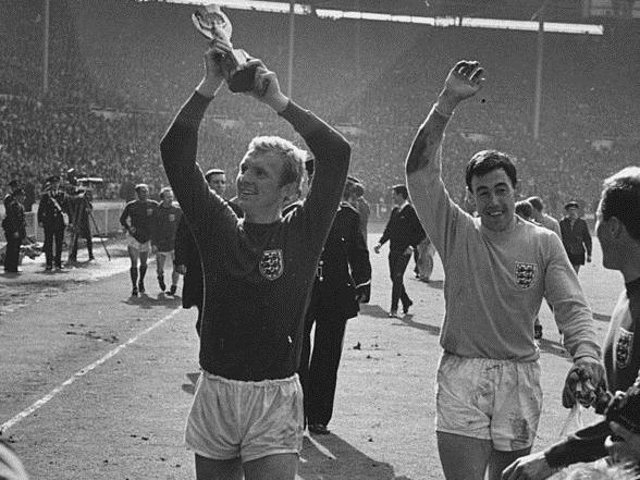 Bobby Moore and Gordon Banks celebrate winning the World Cup. Photo: GettyImages