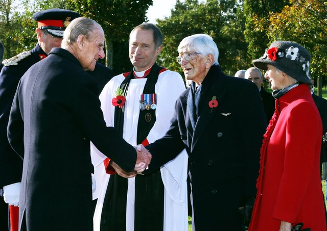 The Duke of Edinburgh greets Dr Sandy Saunders at the unveiling ceremony for a new memorial to the iconic Guinea Pig Club at the National Memorial Arboretum in 2016, watched by Maggie Saunders (right) EMN-210904-170816001