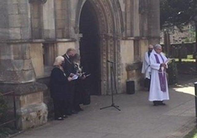 Rev Kevin Ashby take a memorial service for the Duke of Edinburgh outside Melton's St Mary's Church on Sunday morning EMN-210419-095009001