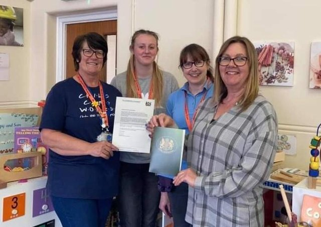Oasis pre-School staff, including manager Victoria Conyers (right), show off the letter from the Lord-Lieutenant of Leicestershire thanking them on their work during the coronavirus pandemic EMN-210419-181058001