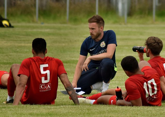 Tom Manship talks to his Melton Town players during a match - they may soon be playing on an advanced 3G football pitch if planning permission is given EMN-210428-140930001