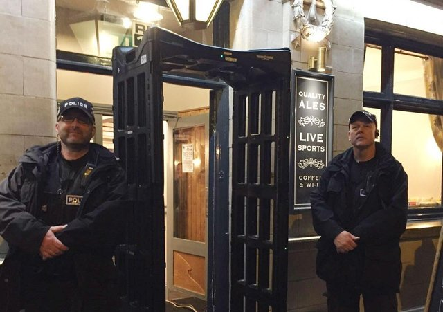 Police officers pictured in 2017 with a knife arch metal-detector outside the Black Swan pub in Melton - it is to be used across Leicestershire again this week as part of a knife crime campaign EMN-210426-134428001