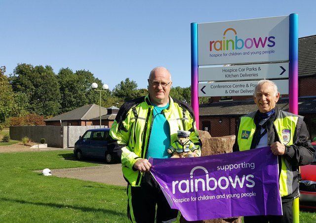 Roy Edwards (right) with fellow International Police Association member, Brian Collins, and Juno the Teddy bear who accompanies them on their tours across the UK and overseas in aid of Rainbows Hospice EMN-210430-135550001