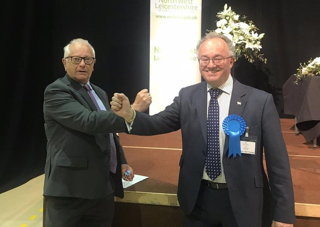 New Leicestershire and Rutland Police and Crime Commissioner (PCC), Rupert Matthews (Conservative Party), on the right, is congratulated on his election victory by outgoing PCC, Lord Willy Bach (Labour Party) EMN-211005-093143001