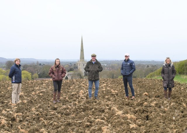 Scott O'Dell, of Fisher German, with Emily, James, George and Clair Goodson at the site of their planned natural burial ground at Bottesford EMN-210515-145341001