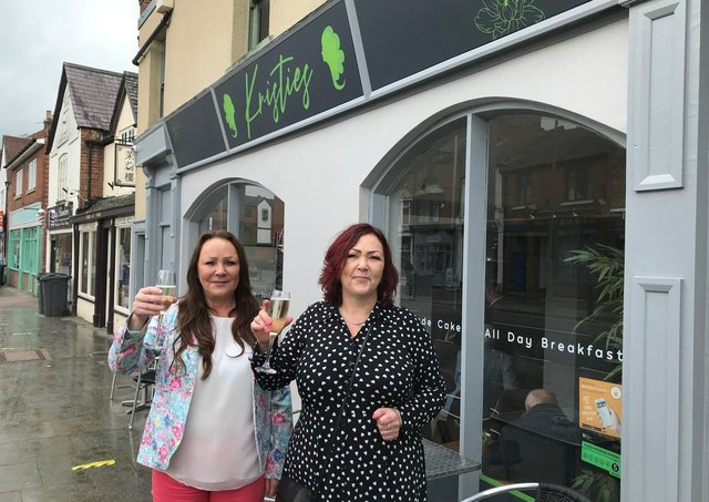 Jolli Waterland (left) outside her new Melton restaurant, Kristie's, with sister Dominique Carnall, mother of the late Kristie Bishop, whose memory inspired the eaterie EMN-210517-174629001