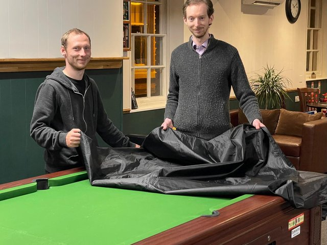Covers off: Owner Ben Jackson (right) and staff member Karl Barratt preparing to reopen Jackson's Lounge after lockdown restrictions were eased this week