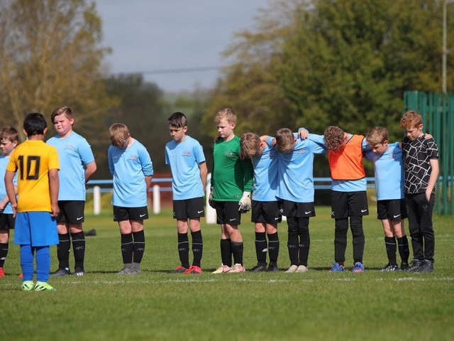 Asfordby's U10 Cobras team and their opponents were among sides to observe a sombre minute's silence on Sunday in memory of first team player Callum Payne, 21, and and young football fan Jordan Banks, who both tragically lost their lives last week. Photo: Phil James