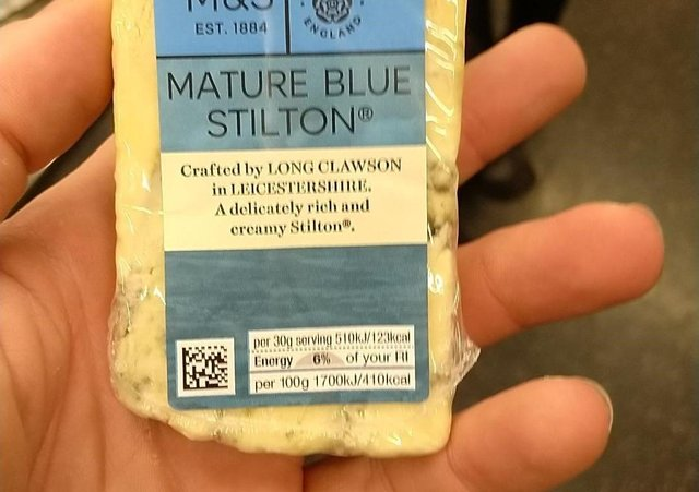 The photo drug dealer Carl Stewart shared of himself holding a block of Stilton made at Long Clawson Dairy which enabled police to analyse his fingerprintsPHOTO MERSEYSIDE POLICE EMN-210525-124552001