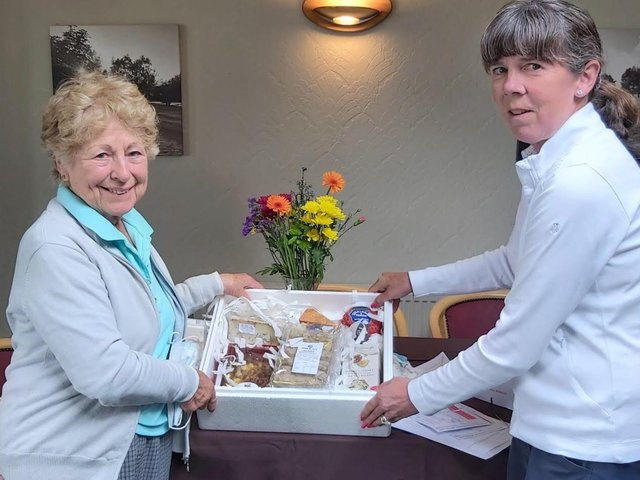 Sue Bennett collects her prize.