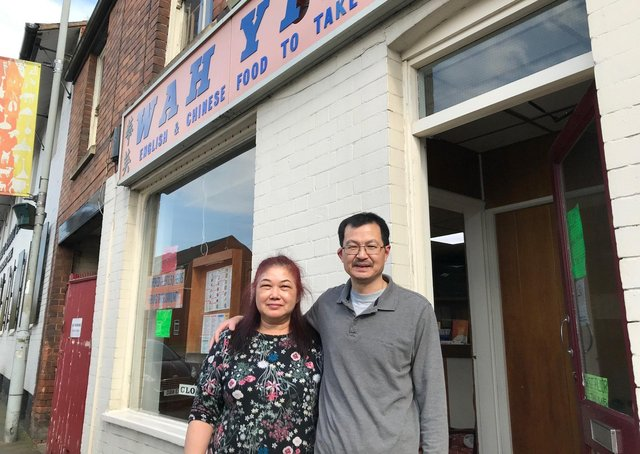 Yam Hee Shing and Tai Ying Shing pictured outside their Wah Ying Chinese takeaway in Thorpe End, Melton, which they are closing todayPHOTO MELTON TIMES EMN-210531-135651001