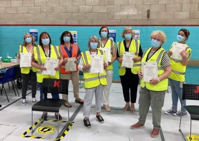 Some of the members of the team at the vaccination centre at Melton Sports Village holding 'thankyou' certificates, which were given to each team member by the local Primary Care Network EMN-210306-174525001