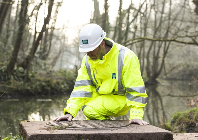 A Severn Trent worker making river checks EMN-210906-142628001