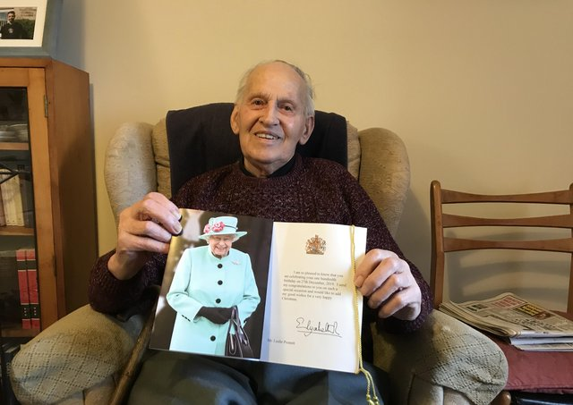 Leslie Posnett, pictured showing off the card he received from The Queen to mark his 100th birthday EMN-210706-174020001