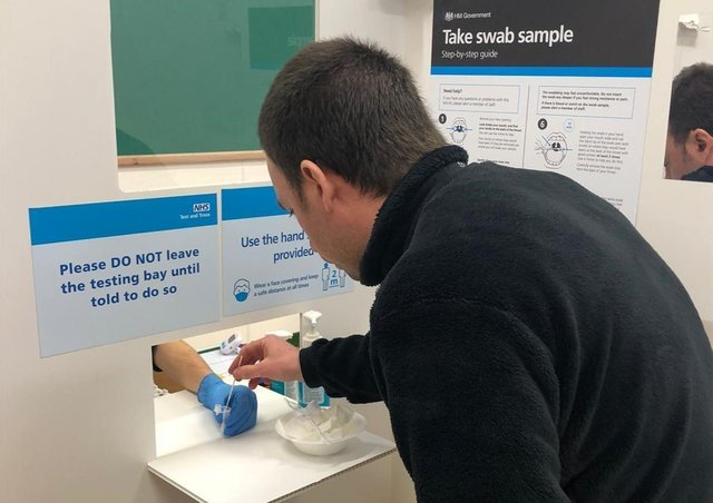 A rapid lateral flow test being taken for coronavirus at a Leicestershire  community site EMN-211106-123033001