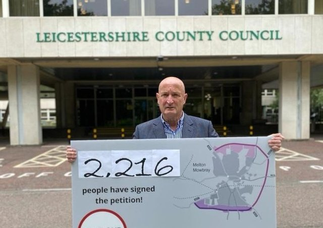 Melton Borough Council leader, Councillor Joe Orson, delivers a petition to County Hall calling on Leicestershire County Council to reconsider its intention to reject £15milllion in government funding towards a proposed southern link to Melton's approve partial bypass EMN-210621-124759001