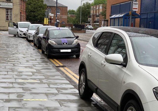 Cars parked on yellow lines in Windsor Street, Melton, on Friday evening EMN-210621-153009001