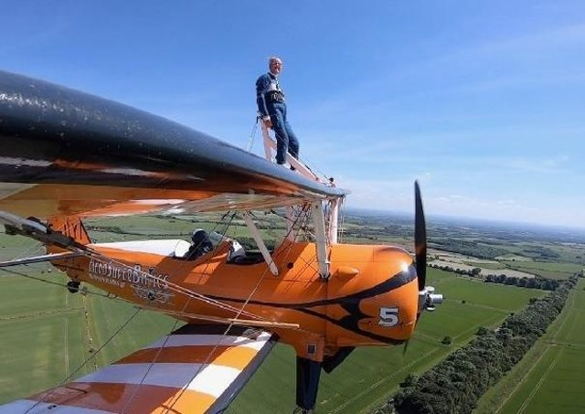 Melton Rotarian Mike Hind-Woodward pictured during his brave charity wing walkPHOTO by Aerosuperbatics EMN-210628-123832001