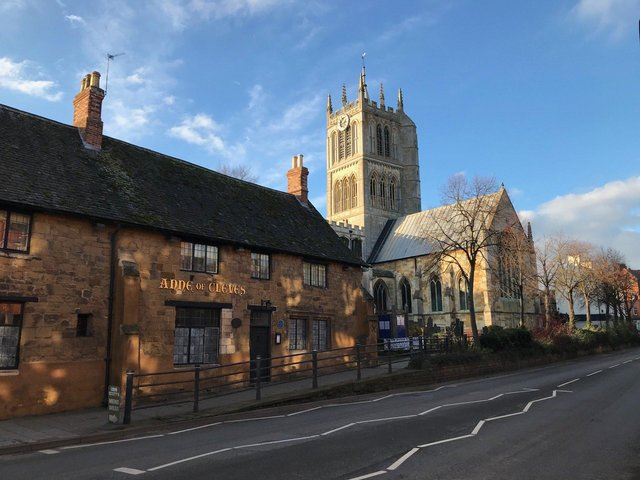 The Anne of Cleves pub and St Mary's Church on Burton Street, in Melton EMN-210707-144514001