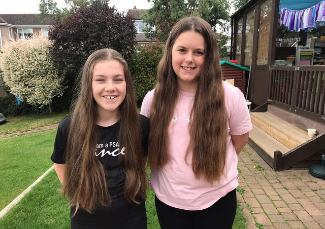 Melton school friends Millie and Lucie who are having their long hair cut in aid of the Little Princess Trust EMN-210107-181454001