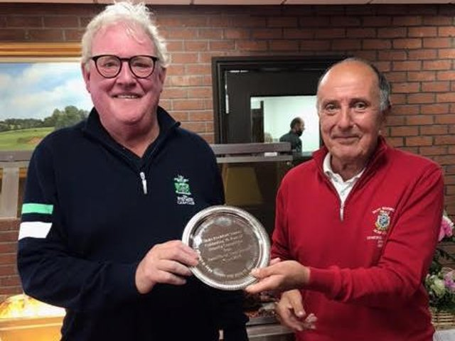 Brian Stone ( Radcliffe) presents the Friendship Trophy to Mike Thornton.