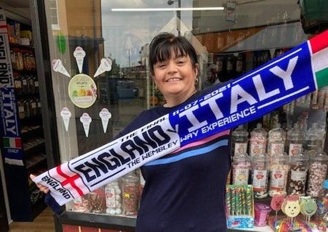 The special Euro 2020 scarf being sold at Melton shop, How Sweet, ahead of Sunday's England v Italy final EMN-210907-145353001