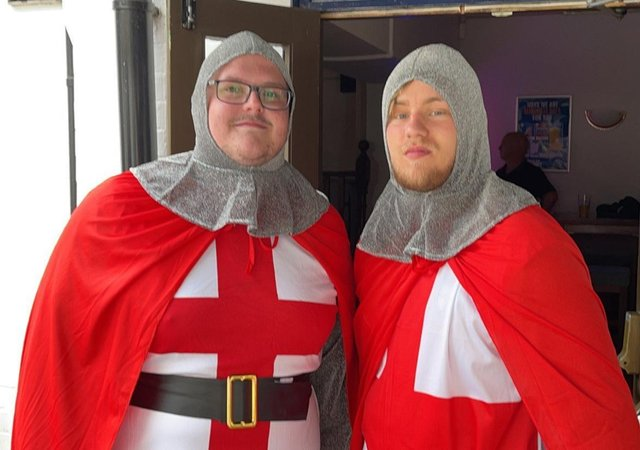 Kyle Hendy and Jake Shelley dressed as St George at Melton's Half Moon pub for the England v Italy Euro 2020 final EMN-211207-095917001